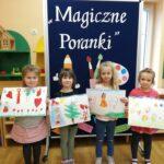 Dzieci z obrazkami wykonanymi pastelami