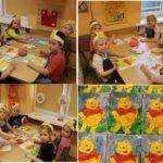 Dzieci malujące farbami Kubusia Puchatka