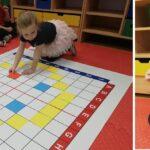 Dziewczynka układa kolorową kartkę na macie do kodowania